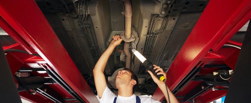 Truck Mechanic Under Ramp